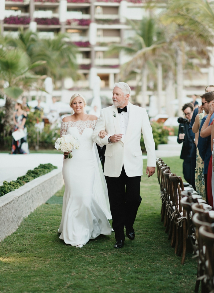 bride being walked down the aisle by her father, wedding ceremony songs, garden wedding, palm trees in the background