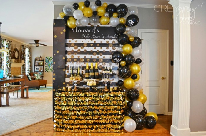 black white and gold balloon arch, hanging over desserts table, 18th birthday ideas for girls