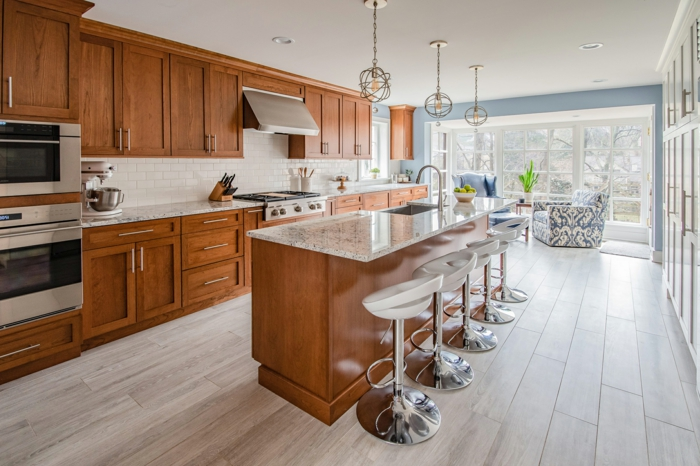 wooden cabinets with granite countertops, mid century modern tile, laminated wooden flooring
