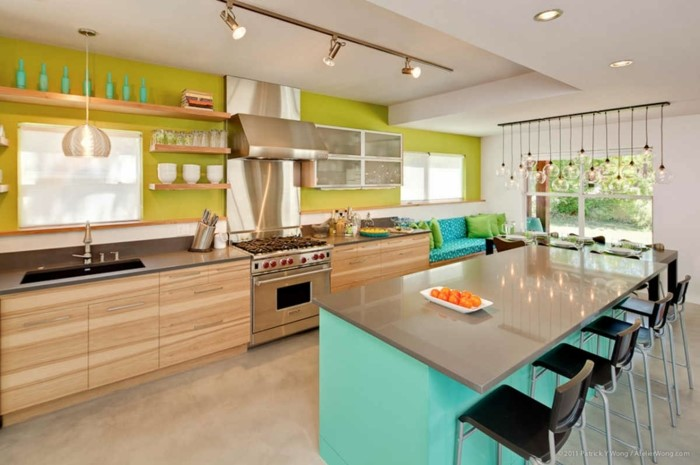 green backsplash, blue kitchen island, mid century modern tile, wooden cabinets with grey countertops