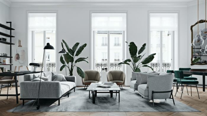 white walls with tall windows, modern living room furniture, grey sofa and armchairs, small coffee table