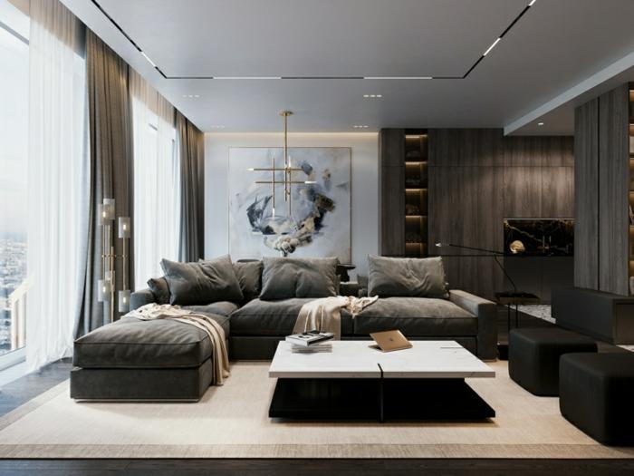 modern living room sets, large grey corner sofa, black ottomans, white coffee table, dark wooden floor with white carpet