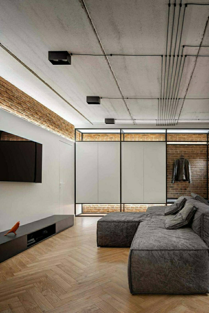 brick walls, grey corner sofa, modern living room sets, wooden floor, small tv cabinet