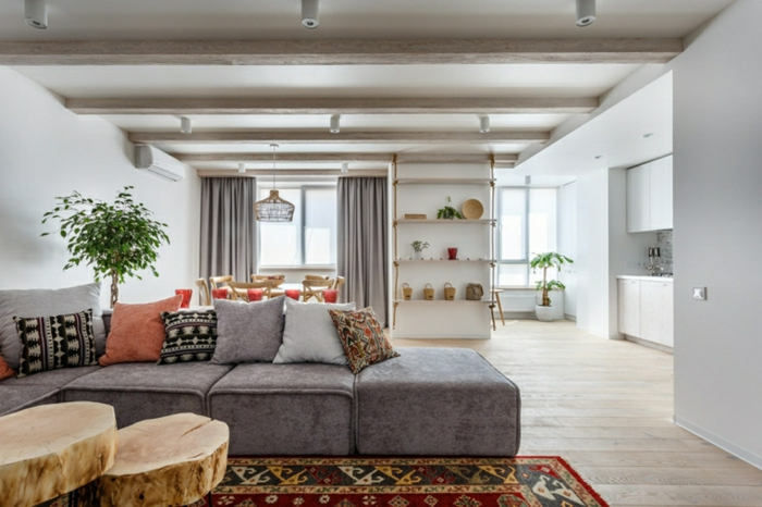 large grey corner sofa, colorful throw pillows, decorations ideas for living room, wooden floor with colorful carpet