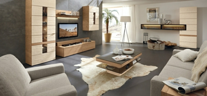 grey floor with white rug, small wooden coffee table, luxury living room furniture, grey sofa and armchair