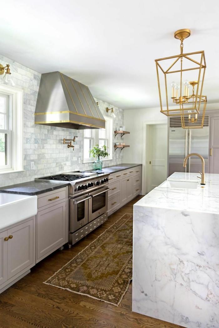 grey and white subway tiles backsplash, mid century modern tile, marble kitchen island, laminated wooden flooring