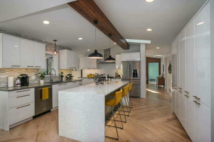 marble kitchen island, mustard yellow bar stools, modular kitchen cabinets, white cabinets with grey countertops
