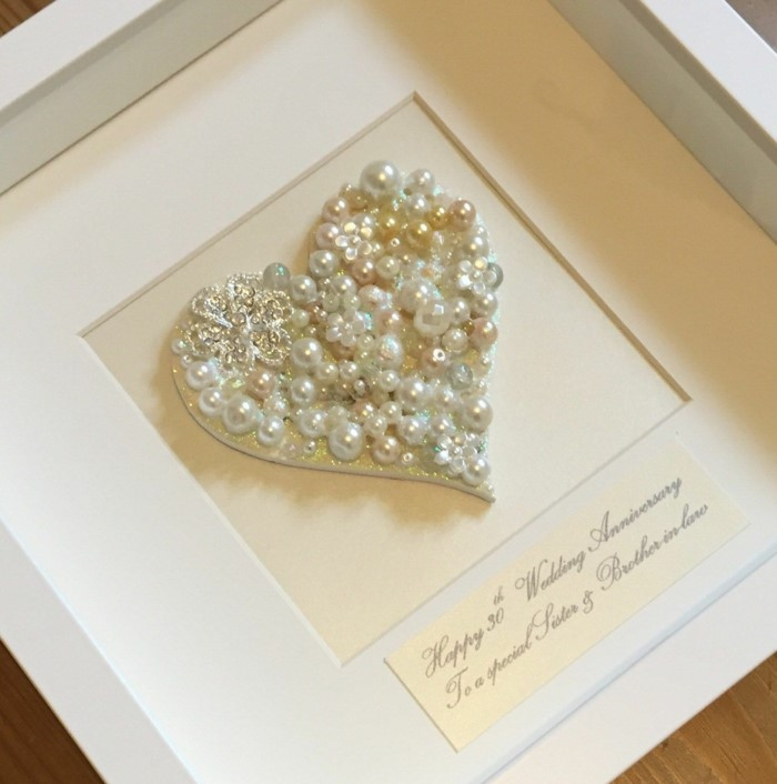 heart made out of pearls, congratulatory message underneath, inside a white wooden frame, 10th anniversary gift