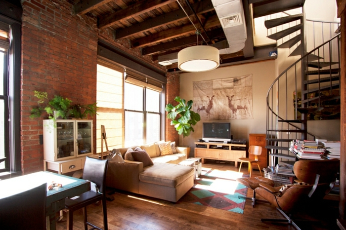 brick wall, wooden floor with colorful carpet, how to decorate your living room, white corner sofa
