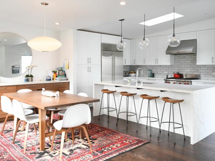 large kitchen island, subway tiles backsplash, modular kitchen cabinets, laminated wooden flooring