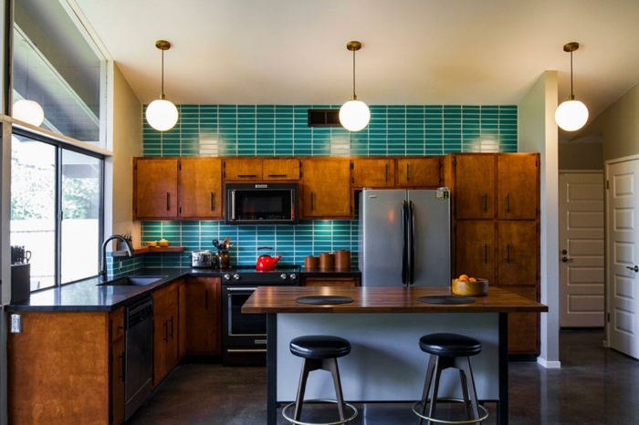 blue subway tiles backsplash, wooden cabinets with black countertops, modular kitchen cabinets