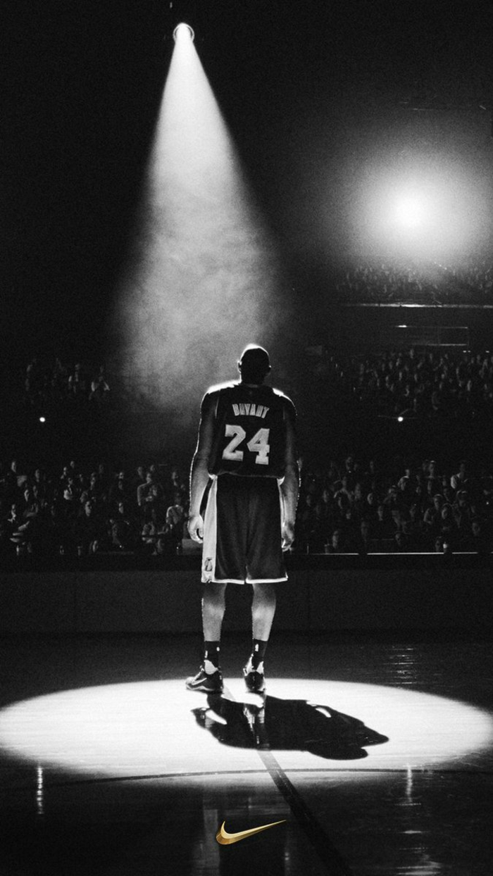 kobe bryant, standing on the court, under a spotlight, nike basketball wallpaper, black and white photo