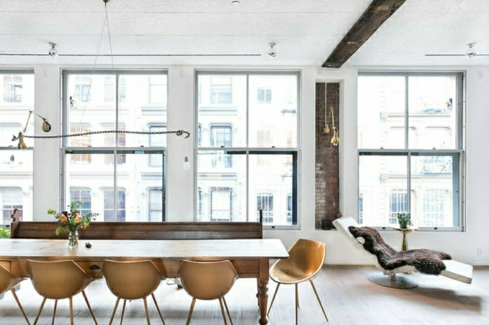 white walls with tall windows, long dining table, home decor ideas for living room, wooden bench and chairs