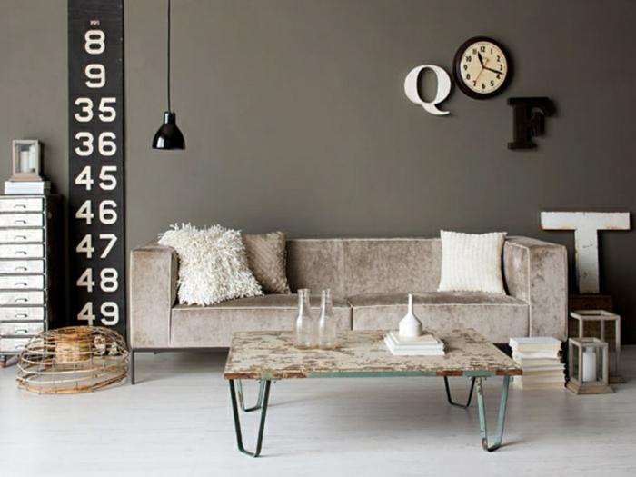 grey walls, modern living room decor ideas, grey sofa, small metal coffee table, white wooden floor
