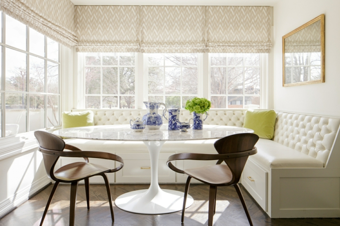 breakfast nook, bench with white cushions, wooden chairs and white table, mid century modern backsplash