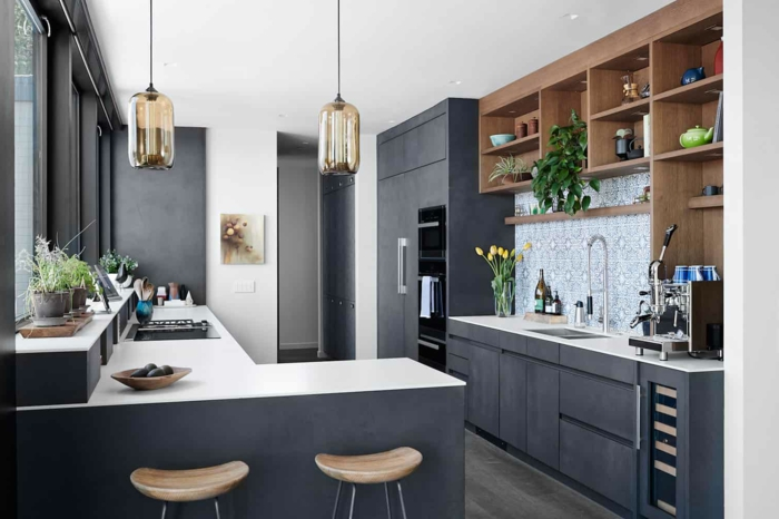 black cabinets with white countertops, mid century modern backsplash, wooden open shelving