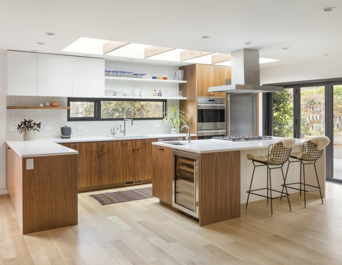 wooden cabinets with white countertops, mid century modern backsplash, laminated wooden flooring