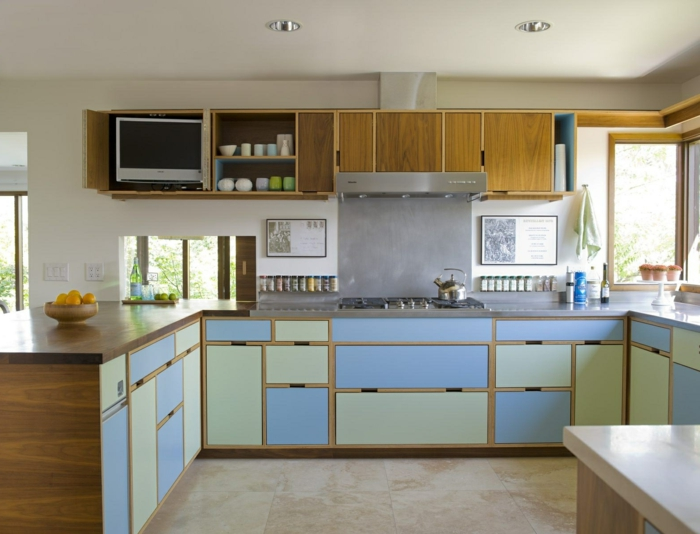 pastel blue and green cabinets, mid century modern kitchen island, grey countertops, tiled floor