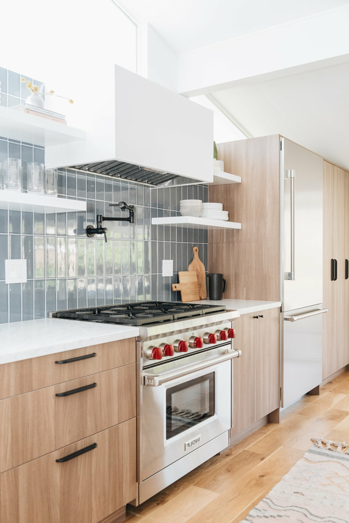 wooden cabinets with white countertops, mid century modern kitchen island, grey subway tiles backsplash