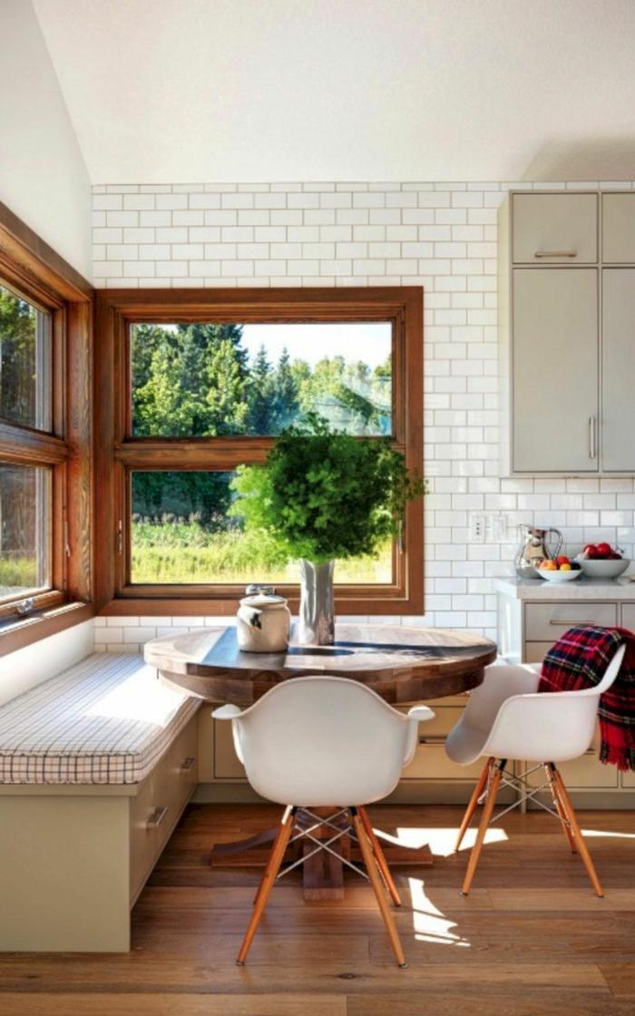 white subway tiles backsplash, mid century modern kitchen island, breakfast nook, round wooden table