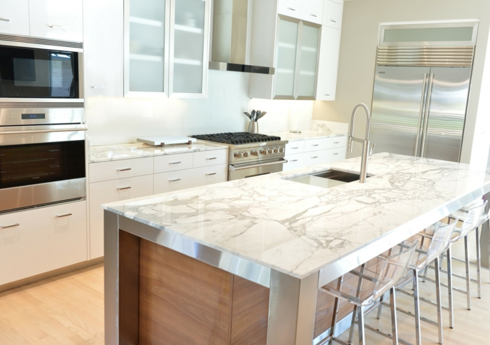 wooden kitchen island, marble countertops, mid century modern kitchen island, white cabinets