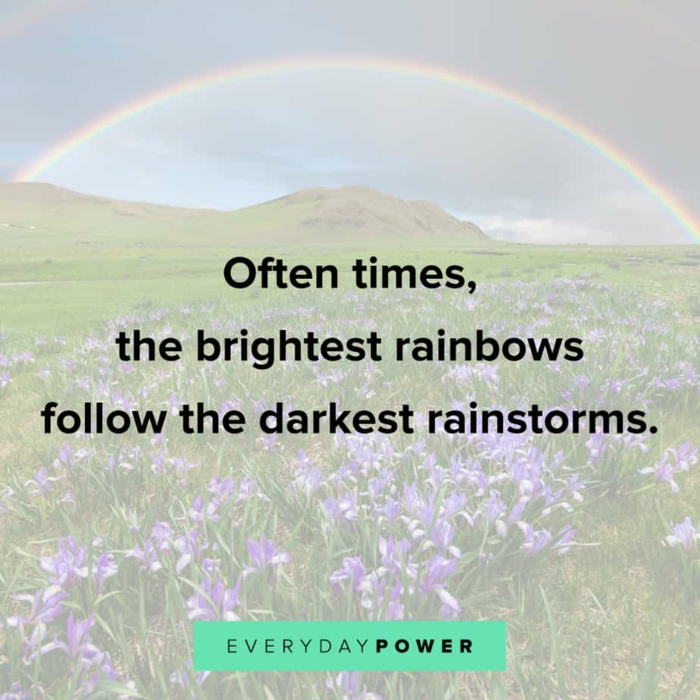 background photo of mountain landscape with rainbow, quotes about getting through tough times, written with black letters