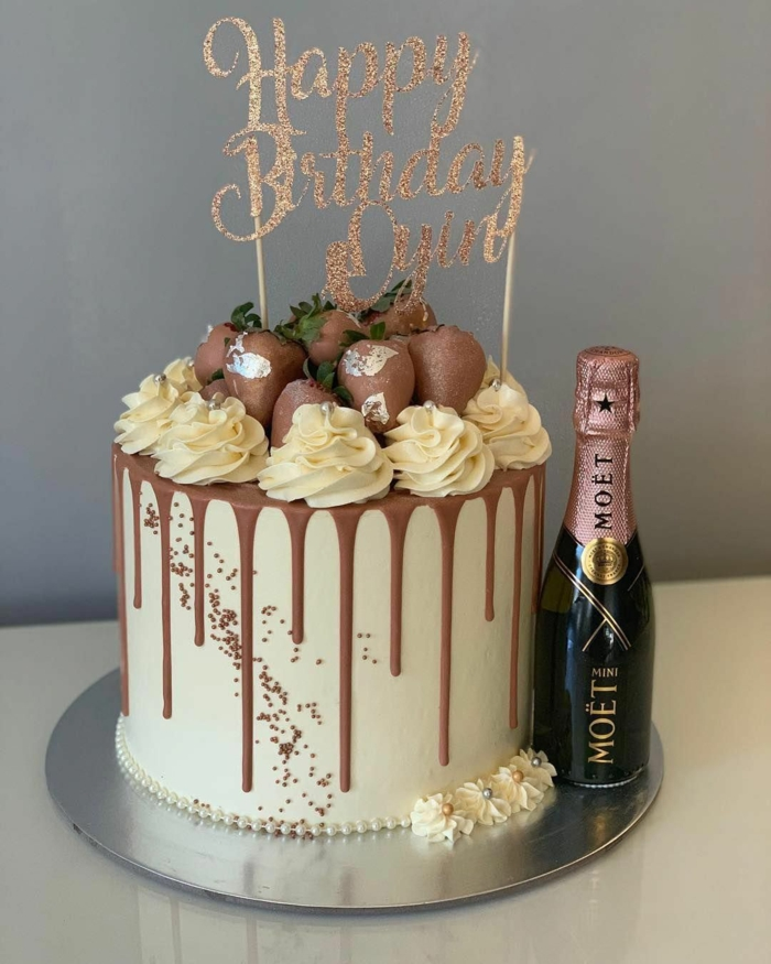 surprise party ideas, one tier cake, chocolate strawberries on top, mini champagne bottle on the side