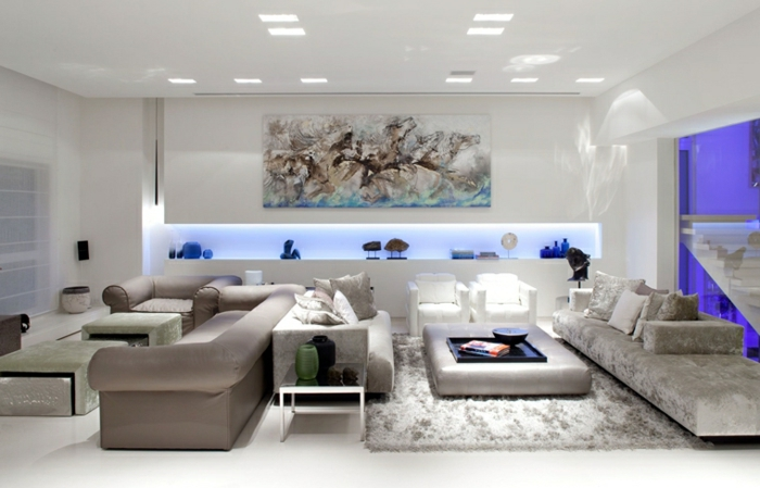 grey sofas, white tiled floor with grey carpet, living room setup ideas, white walls