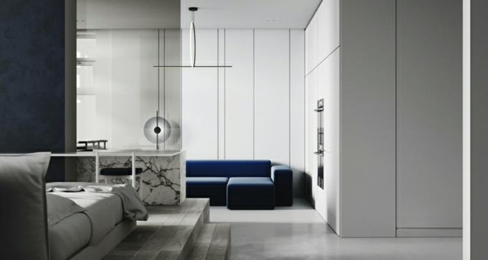 interior design ideas for living room, blue corner sofa, open plan space with living room and bedroom