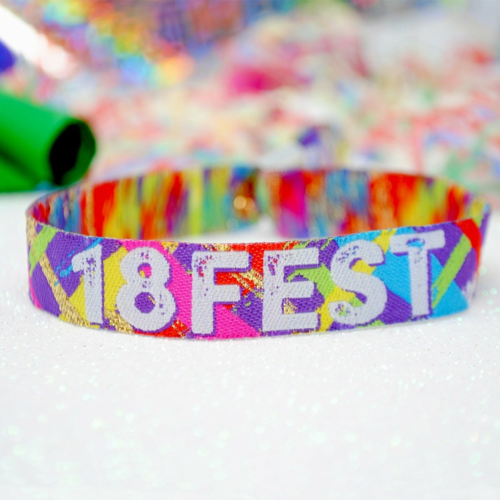 colorful party wristbend, 18 fest written on it with white letters, things to do for 18th birthday, purple pink and green and yellow