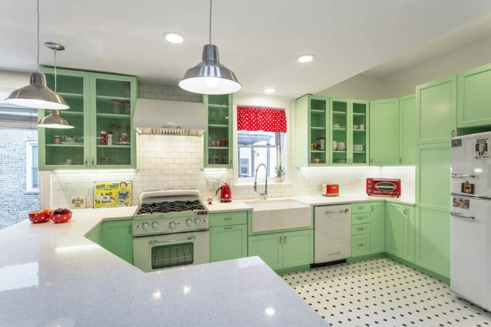 pastel green cabinets, white countertops, mid century kitchen island, tiled floor