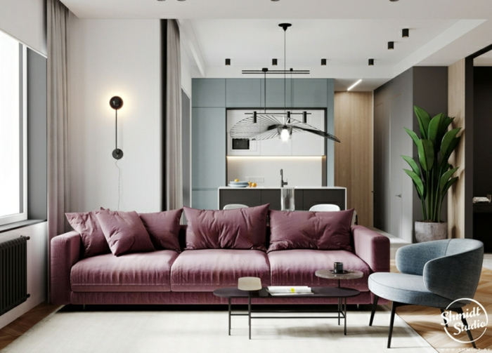 purple sofa and grey armchair, interior design ideas for living room, small black coffee table, wooden floor with white carpet