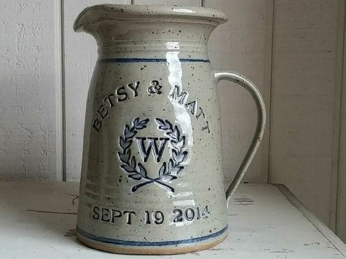 personalised pitcher, betsy and matt, 40th anniversary gifts, dates and names engraved on it, placed on white wooden surface