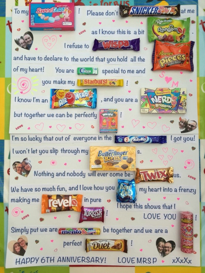 poster with long message, written with candy bars, traditional anniversary gifts, photos glued on it