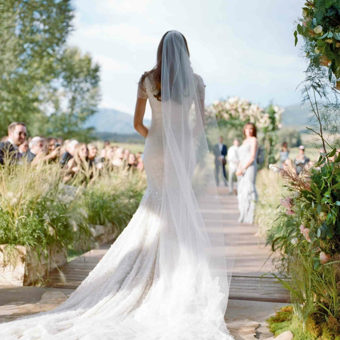 bride walking down the aisle alone, wearing mermaid dress, bride walking down the aisle songs, garden wedding