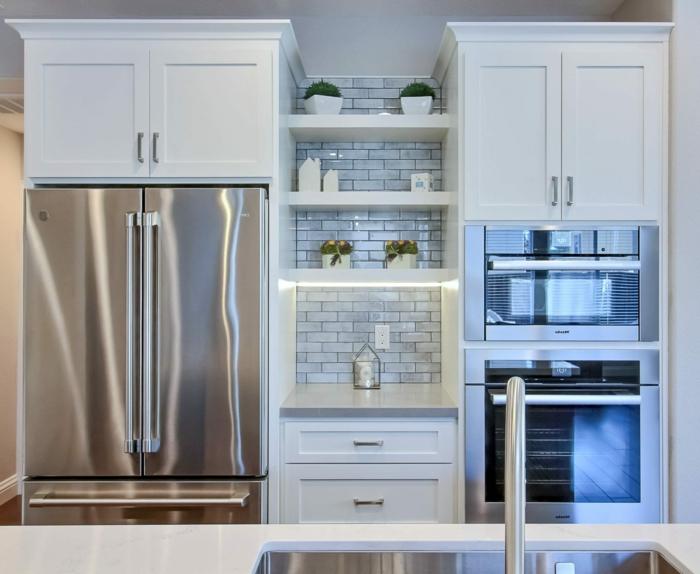 white cabinets, open shelving, mid century modern floor tile, light grey subway tiles backsplash