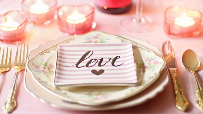 table setting in light pink, small plate with the word love written on it, wedding anniversary gifts