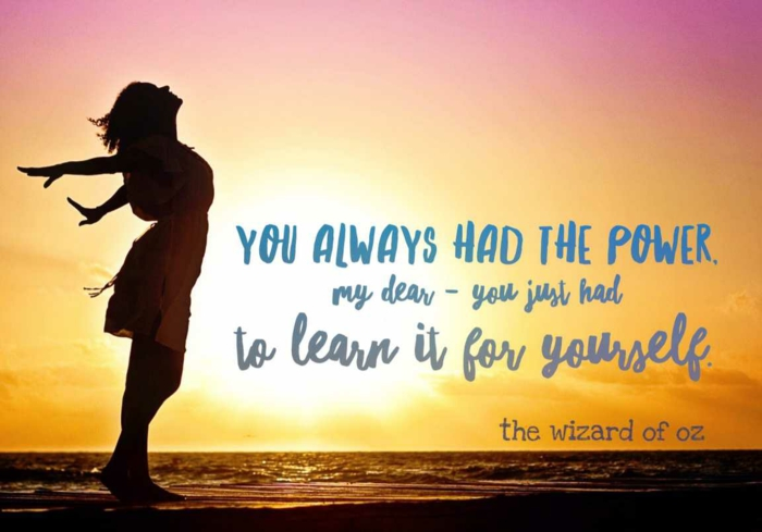 quote from the wizard of oz, positive hopes quote, written with blue letters, background photo of woman at sunset