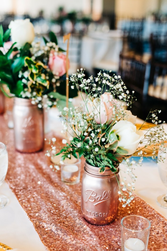 pink and white roses bouquets, placed inside mason jars, painted in rose gold, 18th birthday party ideas, rose gold table runner