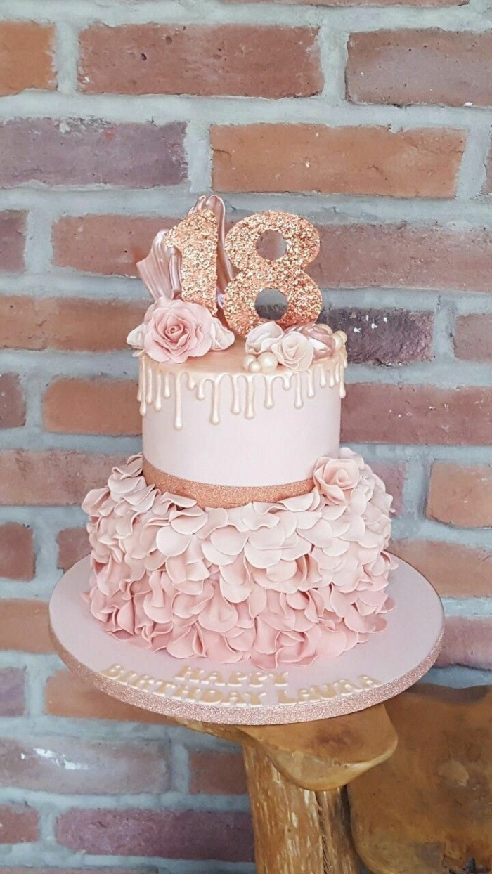 two tier cake, covered with pink fondant and petals, 18th birthday party ideas, rose gold number 18 cake topper