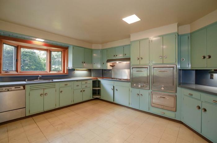 light green pastel cabinets, light grey countertops, mid century modern floor tile, white tiles on the floor