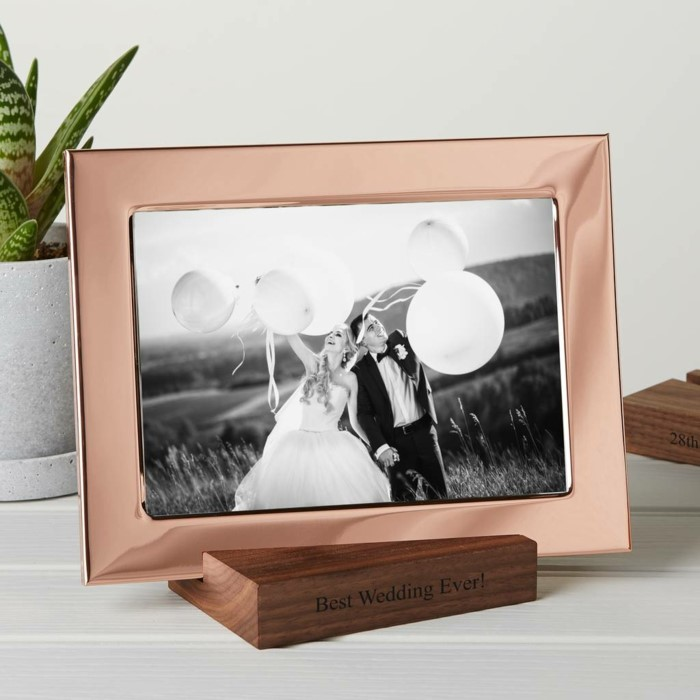 copper photo frame, black and white photo of the bride and groom, 25th anniversary gifts, wooden stand with best wedding ever written on it