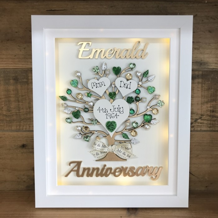 tree made of emerald crystals, inside white wooden frame, anniversary gifts for couples, placed on wooden surface