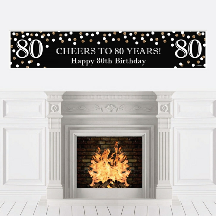 cheers to 80 years banner in black and gold, happy 80th birthday, hanging over a fireplace