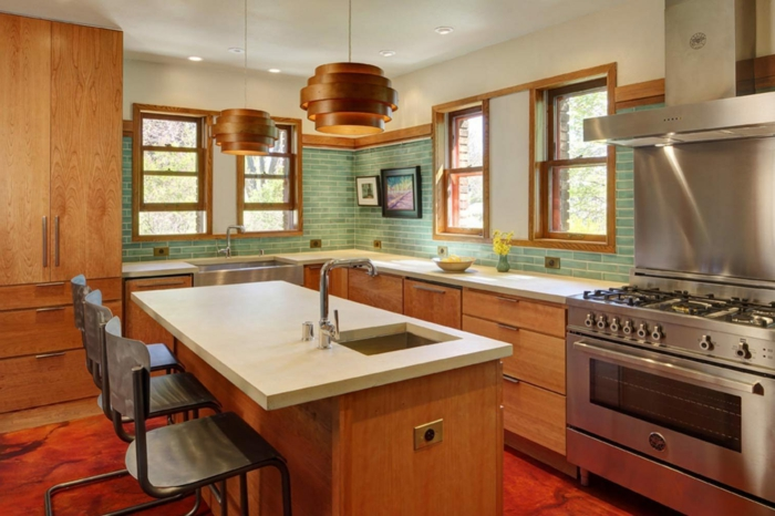 wooden cabinets with white countertops, mid century modern backsplash tile, light green tiles backsplash