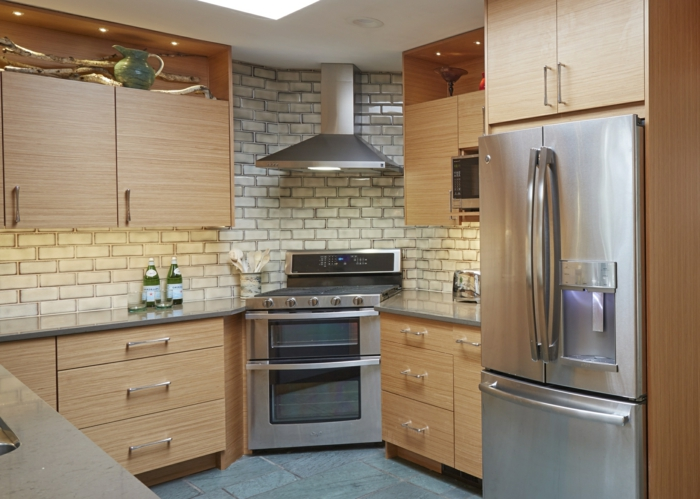 white subway tiles, mid century modern kitchen appliances, wooden cabinets with light grey countertops