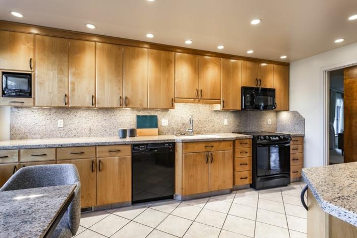wooden cabinets with granite countertops, mid century modern kitchen appliances, mosaic backsplash