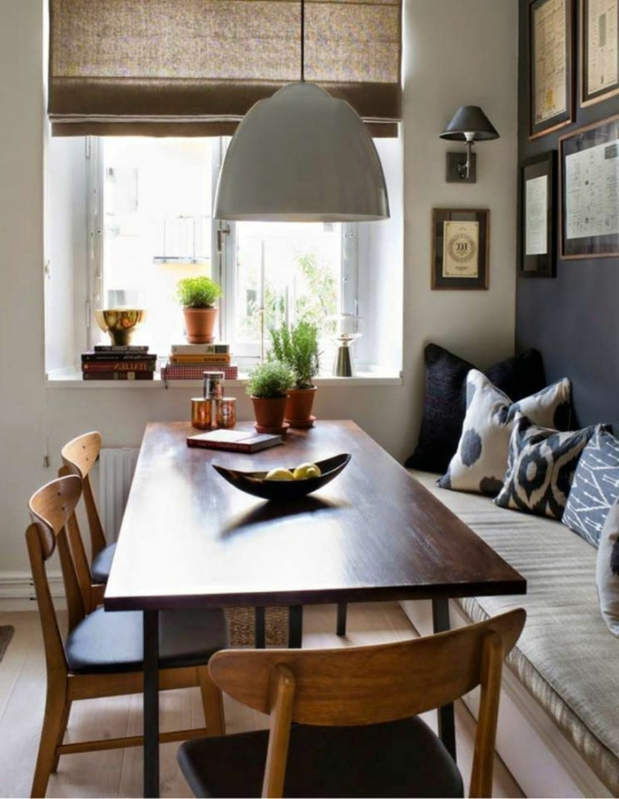 breakfast nook, wooden table and chairs, mid century modern kitchen appliances, black and white throw pillows