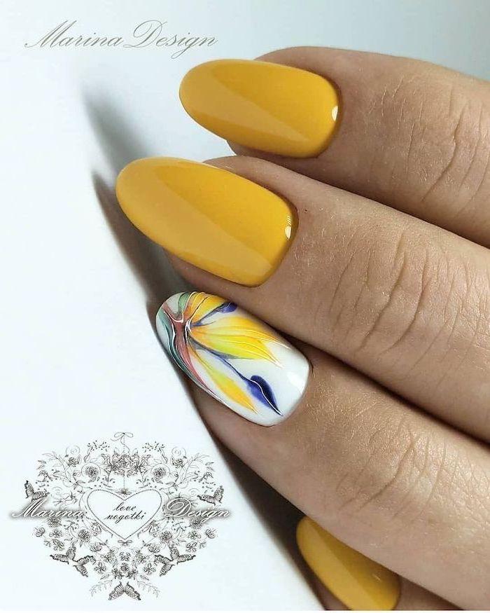 summer nail designs, yellow nail polish, medium length almond nails, abstract flower decoration