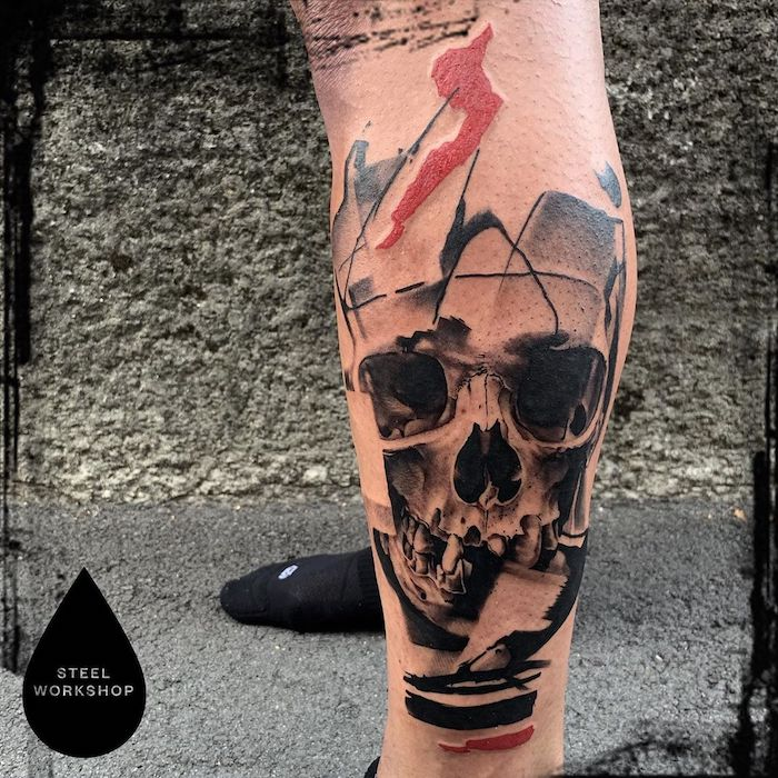 abstract skull surrounded by red black lines trash polka tattoo design leg tattoo